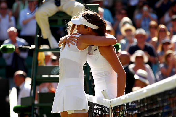 An emotional Vekic embraced Konta at the net (Photo by Clive Brunskill / Getty)