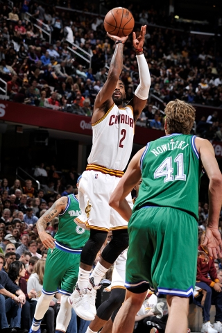 Kyrie Irving shoots over Dirk Nowitzki (David Liam Kyle/NBAE/Getty Images)