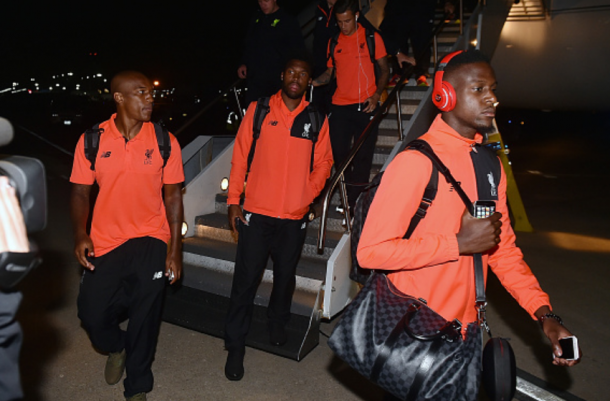 Liverpool players (L-R:) Wisdom, Coutinho, Sturridge and Origi depart a plane during their pre-season tour in America earlier this summer. | Photo: Getty