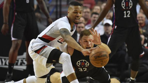 Blake Griffin and Damian Lillard fight for the ball (Steve Dykes/Getty Images)
