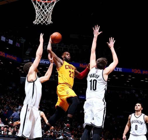LeBron James faces up against Brooklyn's Brook Lopez and Sergei Karasev. (Nathaniel S. Butler/NBAE/Getty Images)