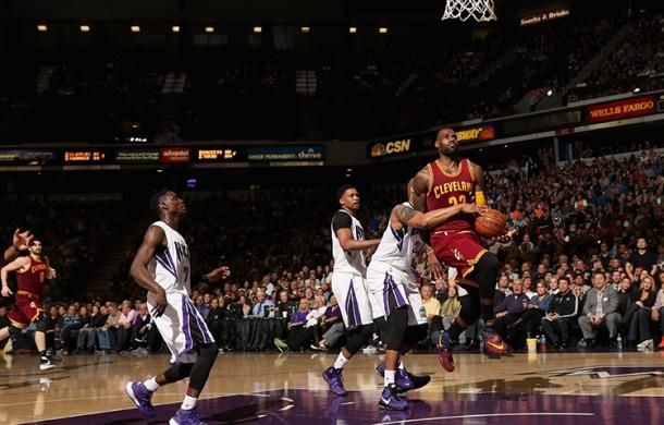 Lebron James gets fouled on a layup attempt against the Kings. (Ezra Shaw/NBAE/Getty Images)
