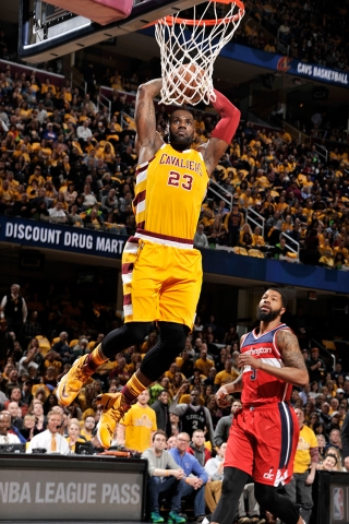 Lebron James goes an emphatic fast-break dunk. (David Liam Kyle/NBAE/Getty Images)