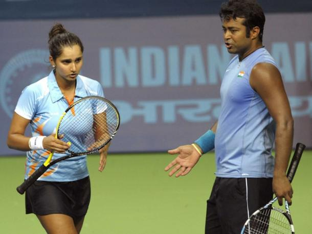 Sania Mirza and Leander Paes talk in-between points. | Photo: AFP