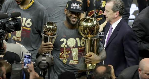 James embracing his first championship with Cleveland. Photo: Ronald Martinez/Getty Images