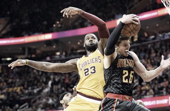 LeBron James (23) battles Kyle Korver (26) for a rebound | Ken Blaze-USA TODAY Sports