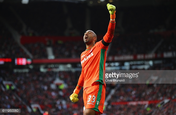 Lee Grant celebrates after the final whistle during the Premier League match between Manchester United and Stoke City at Old Trafford. | Photo: Clive Brunskill/Getty Images