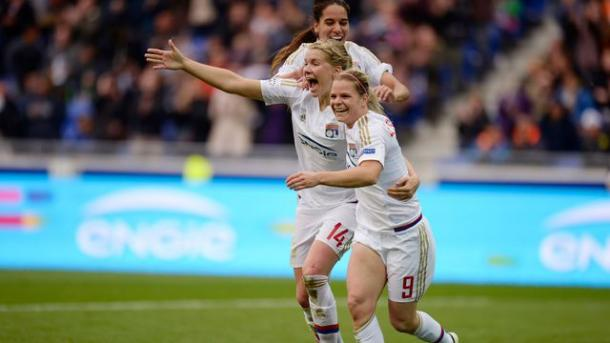 Le Sommer, Hegerberg and Majri celebrating a goal for Lyon | Photo: afp.com/ROMAIN LAFABREGUE