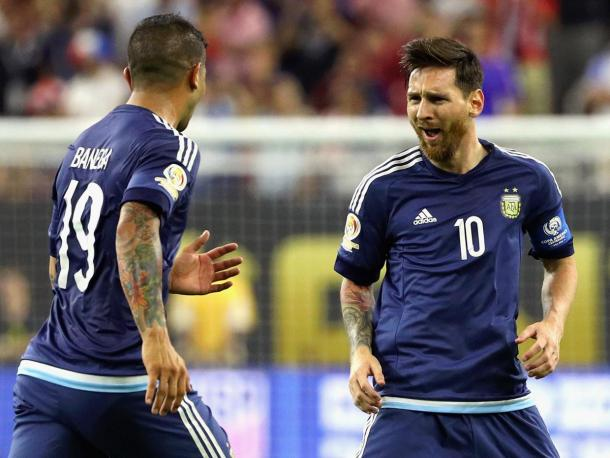 Messi celebrates with a teammate after scoring against the United States (Photo: Getty Images)