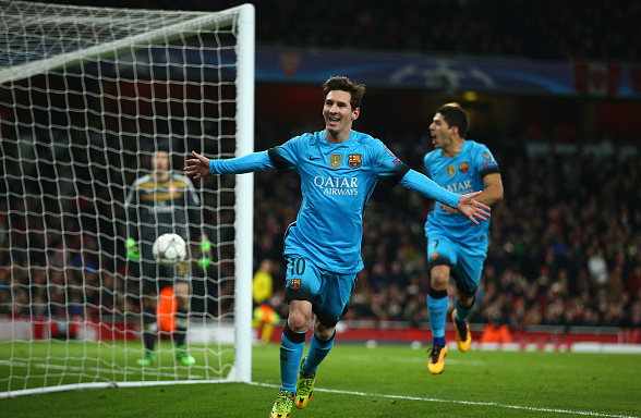 Messi wheels away to celebrate one of his two second-half strikes at the Emirates | Photo: Getty