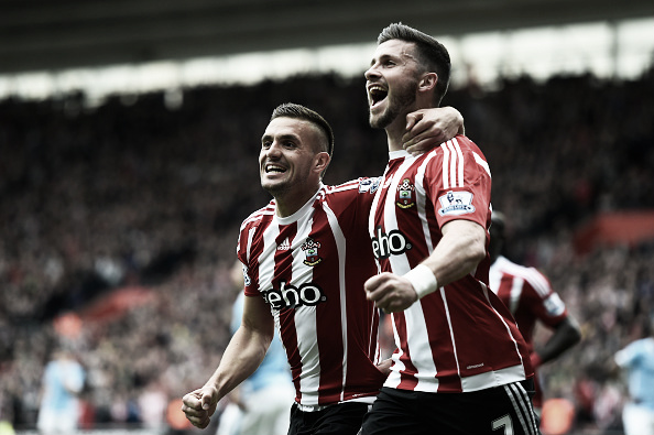 Long (R) celebrates scoring with teammate Dusan Tadic