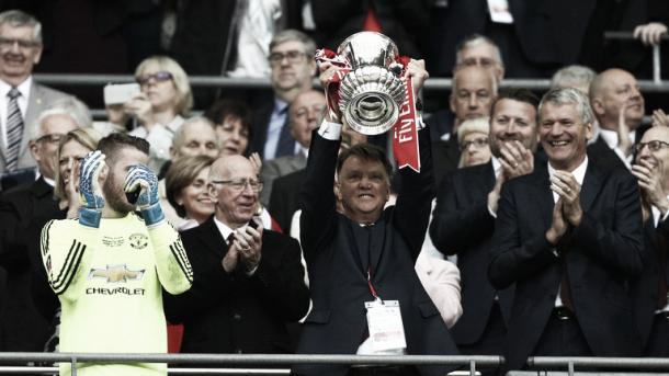 Louis Van Gaal lifts the Emirates FA Cup in his last game as Manchester United manager. Photo: SkySports