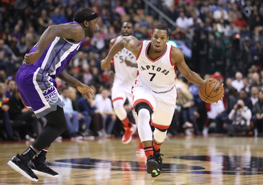 Kyle Lowry drives past Ty Lawson on the fast break