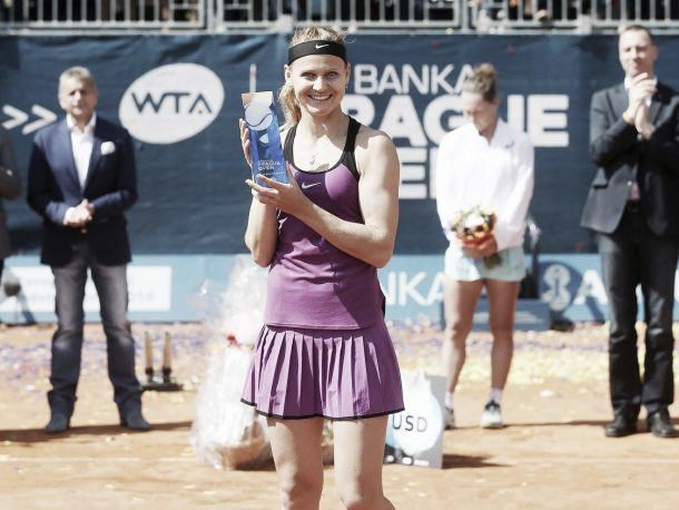 Lucie Safarova lifts her Prague trophee | Source: J&T Banka Prague Open Facebook page