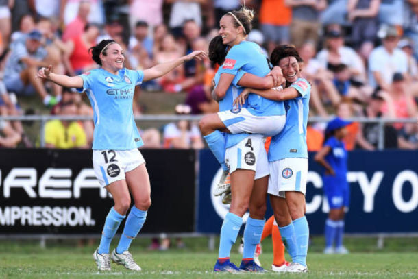 Melbourne City FC midfielder Aivi Luik is lifted up by her teammates after scoring the first goal of the semi-final match against the Brisbane Roar. City would go on to win 2-0. | Photo: Albert Perez - Getty Images
