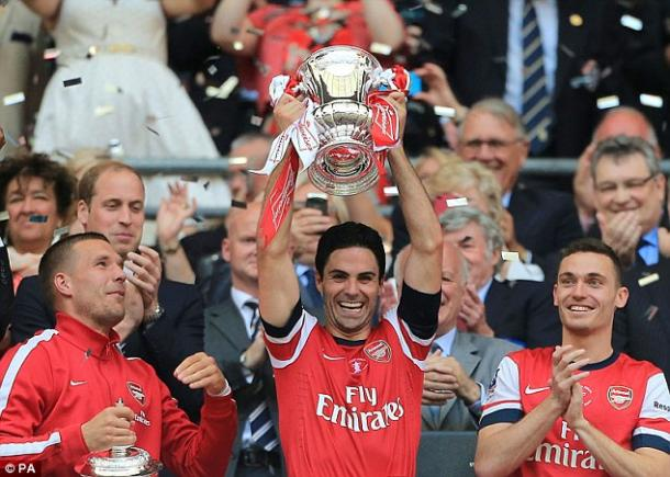 Mikel Arteta hoists the FA Cup aloft after Arsenal's victory against Hull City. | Image source: PA - Daily Mail