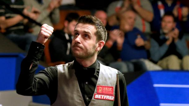 Mark Selby celebrates after securing a place in the final. | Photo: REX Features