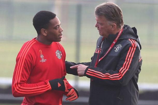 Martial, pictured here in training with Louis van Gaal, has refused to get drawn into rumors discussing the manager's future. | Source: John Peters/Manchester United FC