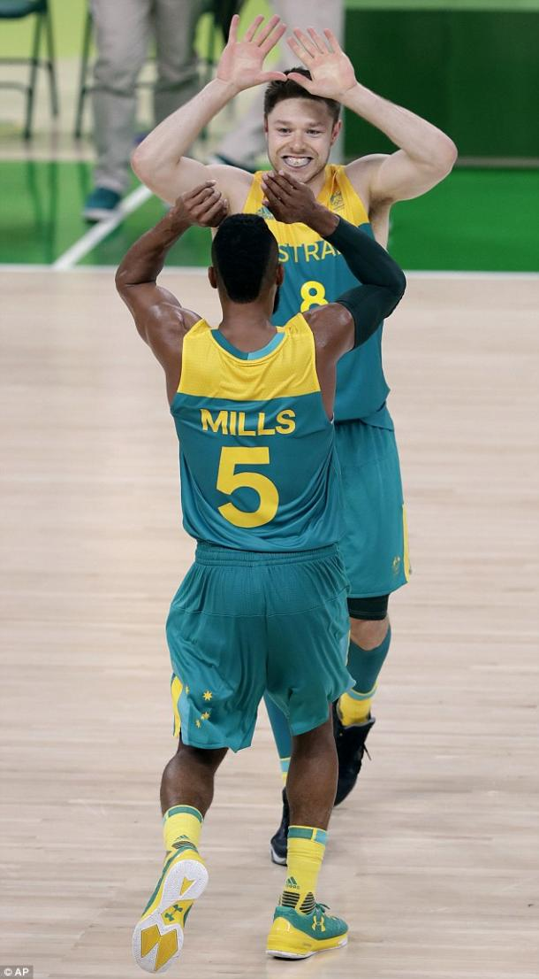 Patty Mills (5) and Matthew Dellavedova (8) have been outstanding for the Boomers. Photo: Associated Press