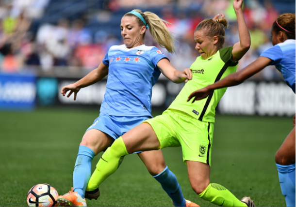 Mathias challenges Chicago Red Stars midfielder Julie Ertz, but commits a foul in the process. | Photo: Quinn Harris - Icon Sportswire via Getty Images