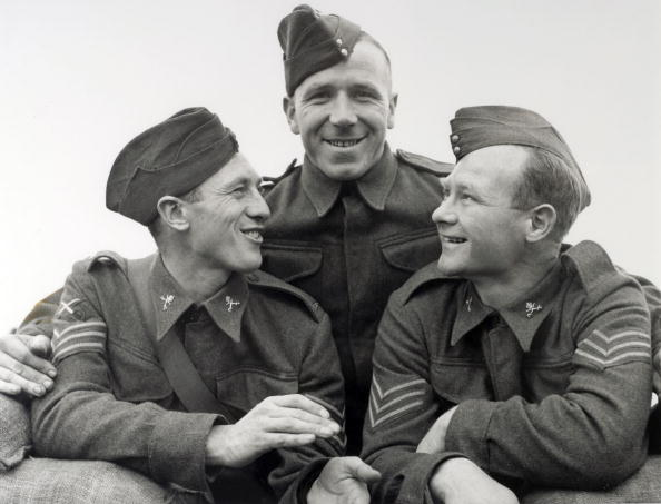 Busby with Everton's Joe Mercer and Charlton's Don Welsh during the war (1939)