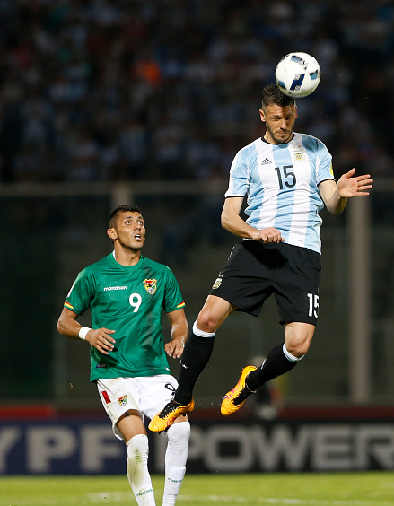 Demichelis (far right) jumps to head the ball in Argentina's World Cup qualifier v Bolivia, on Tuesday | Photo: Getty