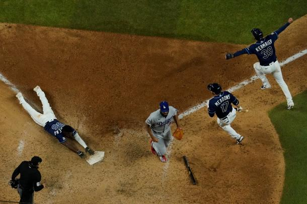 Arozarena slides in with the winning run in Game 4/Photo: David J. Phillip/Associated Press