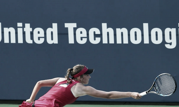 Getty Images: Mertens reaches for Cibulkova's swing volley