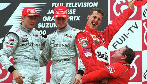 Schumacher festeggia il titolo con Jean Todt sul podio di Suzuka