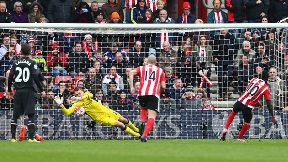 Simon Mignolet gets down to save Sadio Mane's penalty: Photo: Michael Steele, Getty