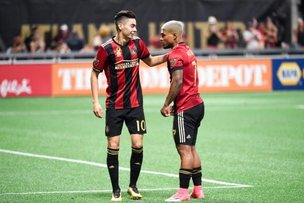 Miguel Almiron (left) and Josef Martinez (right) share a chat during a 3-0 win over FC Dallas. (Source: Adam Hagy/USA Today Sports)