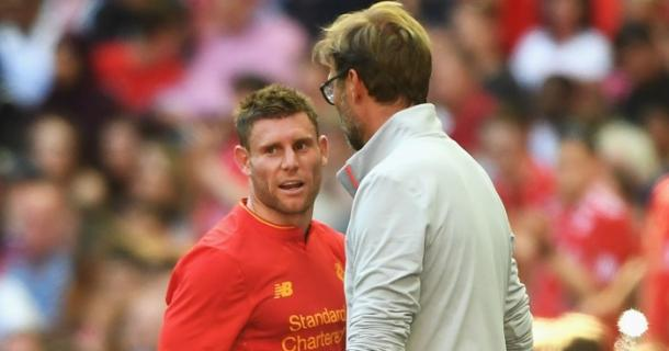 Milner speaks with Klopp after being brought off against Barcelona. (Picture: Getty Images)