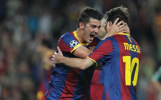 Villa celebrando un gol con Messi. | FC Barcelona