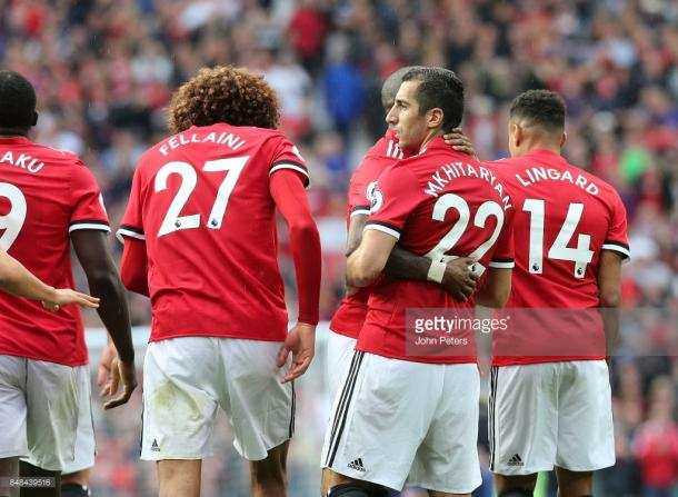 Henrikh Mkhitaryan is congratulated by his teammates for his goal against Everton. (Photo credit: John Peters/Getty Images)