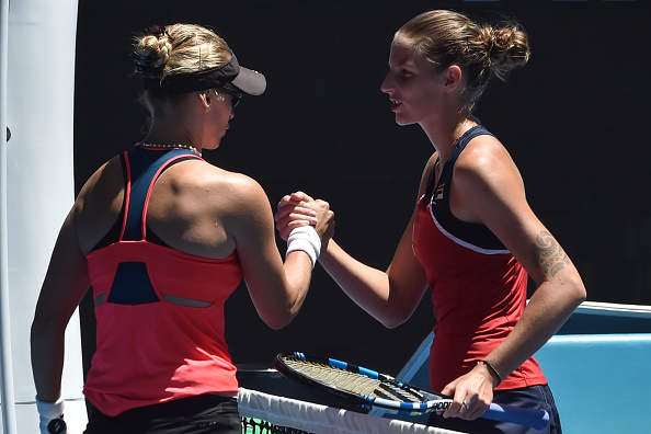 Lucic-Baroni and Pliskova shake hands at the net (Photo by Paul Crock / Getty Images)