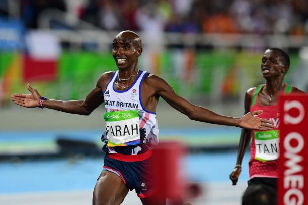 Mo Farah crosses the finish line just ahead of Paul Tanui to repeat as champion of the 10,000 meters/Photo: Getty Images