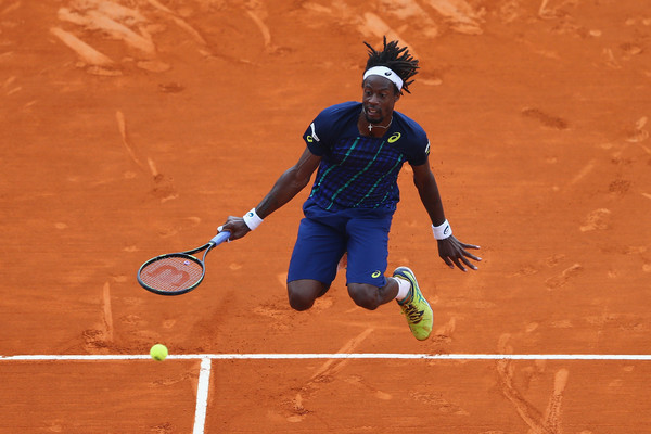 Gael Monfils of France jumps to return the ball during the singles final match against Rafael Nadal of Spain during day eight of the Monte Carlo Rolex Masters. Source: Getty Images
