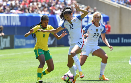 Motlhalo (#8) waits to attack United States midfielder Christen Press (#12) while midfielder Allie Long (#23) provides support. | Photo: Patrick Gorski - Icon Sportswire via Getty Images