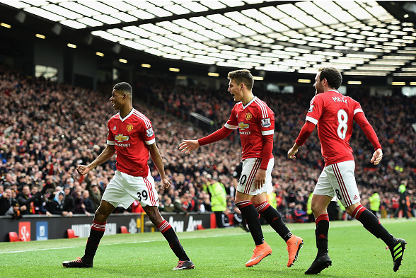 Rashford wheels away to celebrate one of his two goals v Arsenal alongside Spanish duo Herrera and Mata | Photo: Getty Images