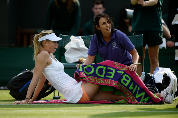 Sharapova received treatment after falling a number of times on Court Two
