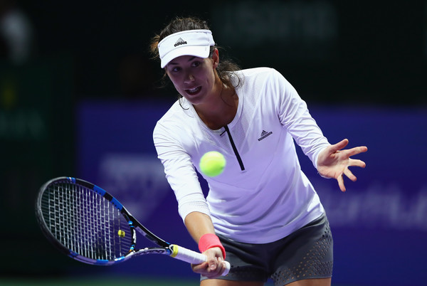 Muguruza during a practice session prior to the WTA Finals in Singapore (Photo by Clive Brunskill / Getty Images)