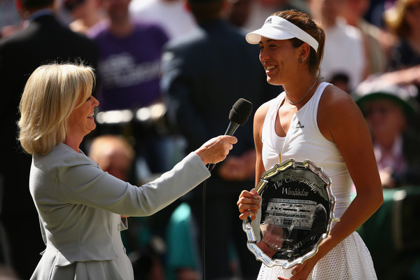 Muguruza (right) was all smiles in her post-match interview with fellow former French Open champion Sue Barker (left) at the conclusion of the Ladies' singles final in 2015 (Photo by Clive Brunskil / Getty)