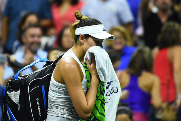 Muguruza leaves the court following a shocking second round loss to Sevastova at the US Open (Photo by Alex Goodlett / Getty Images)