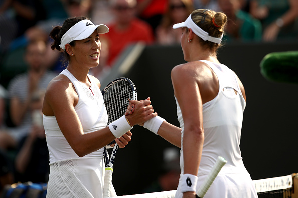 The duo shake hands at the net (Photo by Julian Finney / Getty)