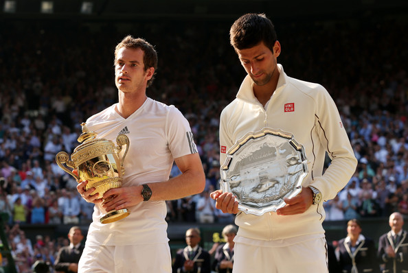 Murray and Djokovic posing with their respective trophies following their Wimbledon final meeting in 2013 (Photo by Clive Brunskill / Getty Images)