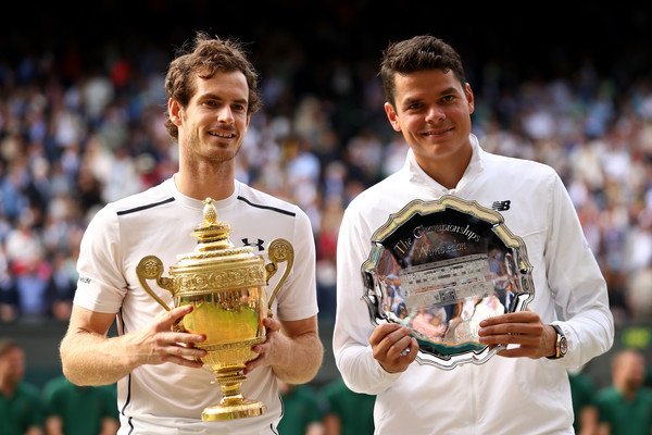 Murray and Raonic hold their respective trophies after the conclusion of last year's Wimbledon final (Photo by Julian Finney / Getty)
