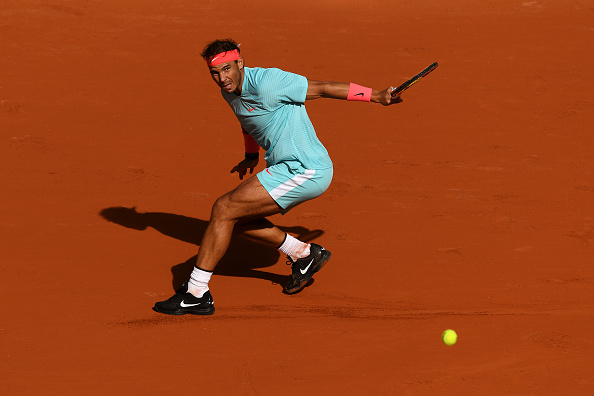 Nadal sliding to victory (Shaun Botterill/Getty Images)