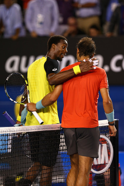 Monfils and Nadal at the net following their previous meeting at the Australian Open in the third round in 2014 (Photo by Cameron Spencer / Getty Images)