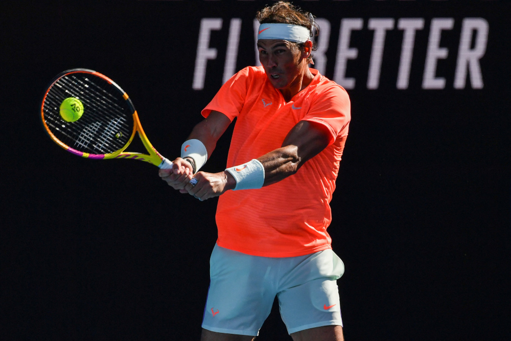 Nadal plays a backhand in his fourth-round victory/Photo: Paul Crook/AFP