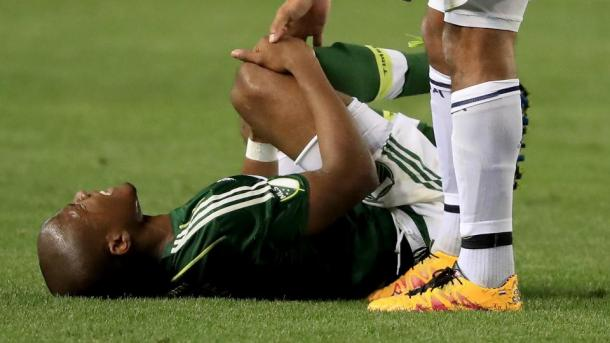 Nagbe clutches his leg after De Jong's late challenge. (Source: Sean M. Haffey/Getty Images)
